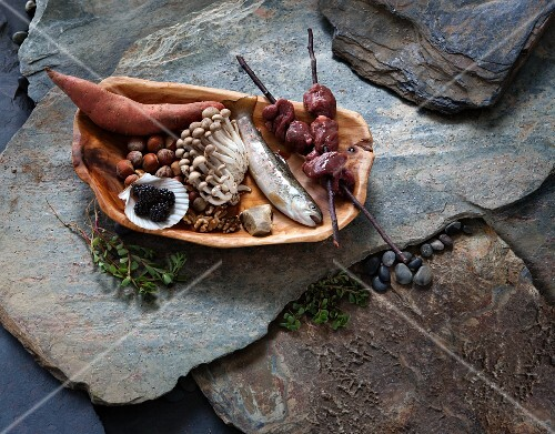 Paleolithic Diet Ingredients on a Plate on Stone