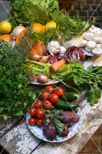 Assorted vegetables, herbs and oranges