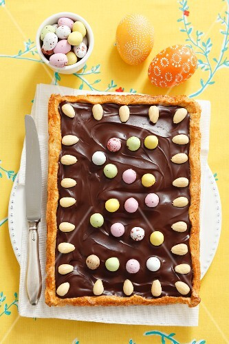 Mazurek (Polish Easter cake) with chocolate, almonds and sugar eggs