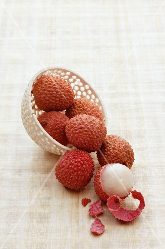 Lychees, one half peeled