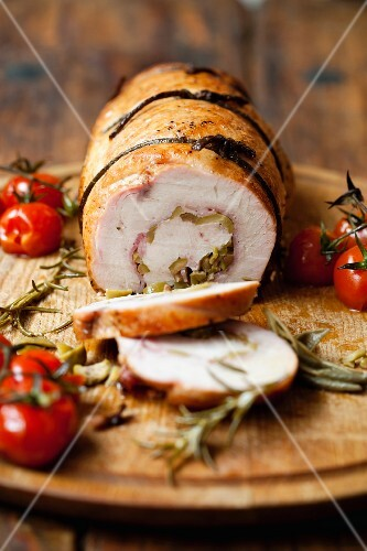 Turkey roulade on a wooden board