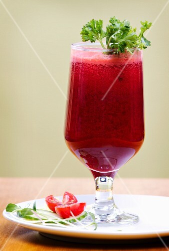 Freshly pressed vegetable juice garnished with parsley