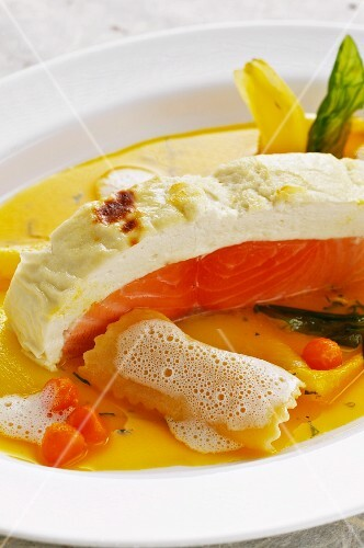 Souffléed salmon in a carrot and chicory broth with ravioli