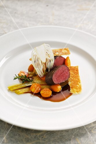 Saddle of venison with fennel, physalis and spiced bread
