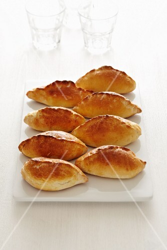 Bread rolls filled with rice and a and cups of milk (Russia)