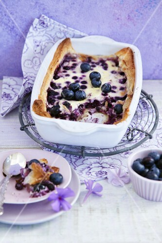 Berry casserole in a casserole dish and a small plate with a spoon
