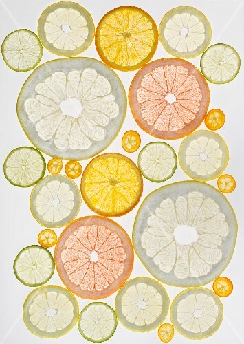 Various sliced citrus fruits (seen from above)