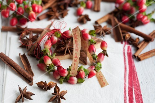 Small wreath of St. John's wort berries with cinnamon sticks, star anise and lettering