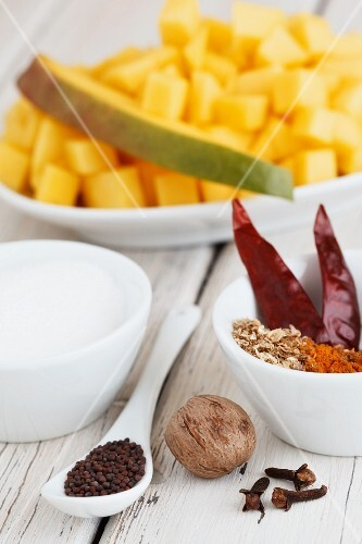 Ingredients for mango chutney: mango, chilli peppers, sugar, nutmeg, cloves, mustard seeds, turmeric, cumin
