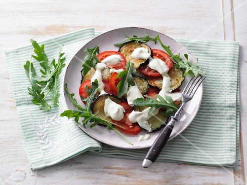 Aubergine and tomato carpaccio with cream cheese and rocket