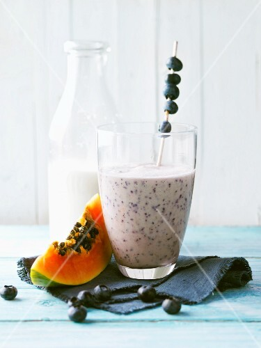 Papaya and blueberry shake with almond mousse and walnut oil