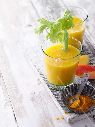 Pineapple and mango shake with celery and turmeric