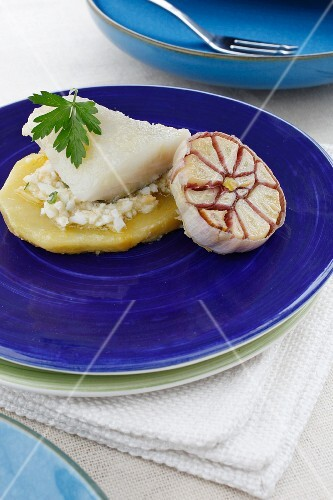 Cod fillet on potato with an egg