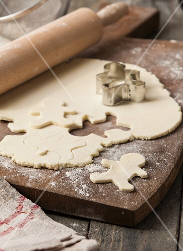 Gingerbread men being cut out