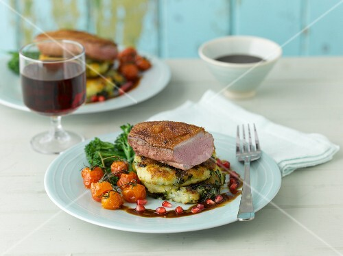 Duck breast on a potato and kale fritters
