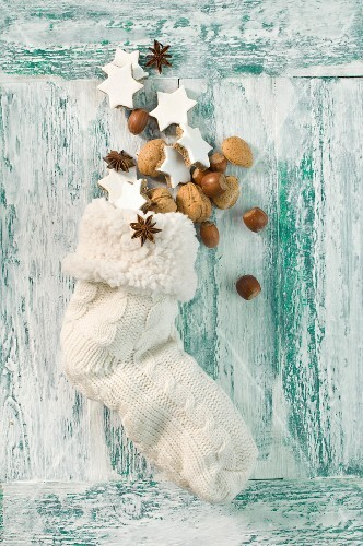 Cinnamon stars, nuts and anise starts in a Christmas stocking