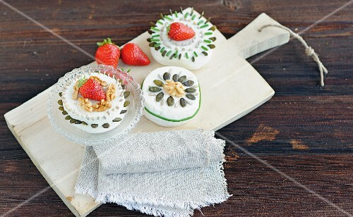 Goat's cream cheese with various seeds, chives and strawberries