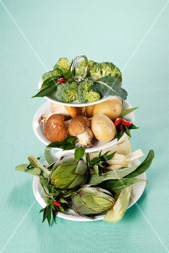 Various vegetables on a cake stand