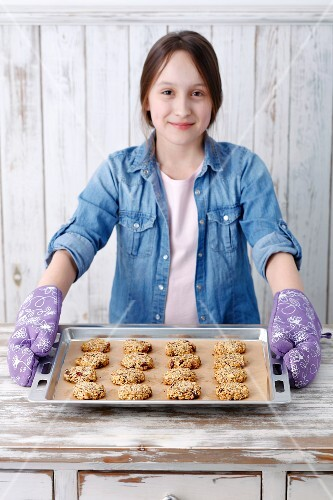 A girl with freshly baked muesli biscuits