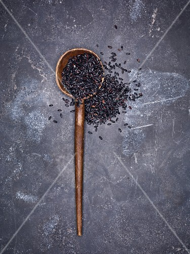 Black rice on a wooden spoon