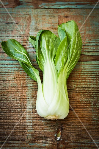 Bok choy on a wooden surface