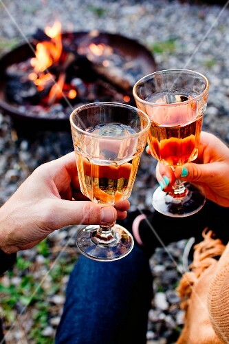 A couple toasting with rose wine