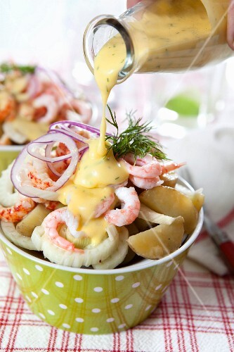 Potato salad with fennel, crustaceans, red onions and mustard dressing
