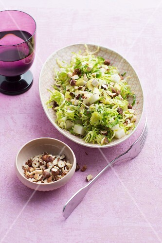 Brussels sprouts salad with pear and hazelnuts