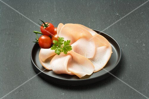 Turkey ham and cherry tomatoes on a plate