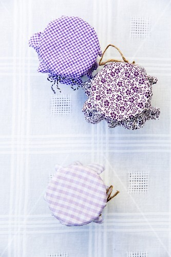 Jam jars with various fabric decorations