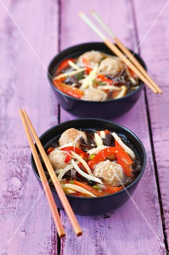 Broth with pork meatballs, Mu-Err mushrooms, bamboo shoots, rice noodles and peppers