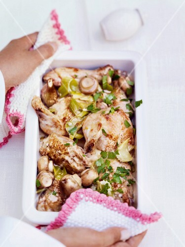 Roast chicken legs with mushrooms and celery