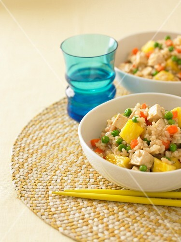 Pineapple and tofu rice with carrots and peas