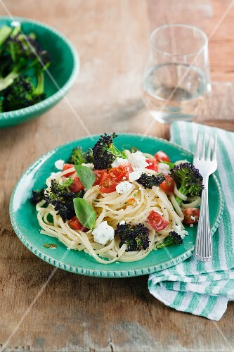 Linguine with purple broccoli, tomatoes, chilli, basil and feta cheese