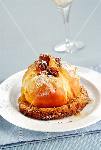 A baked apple served on a slice of panettone