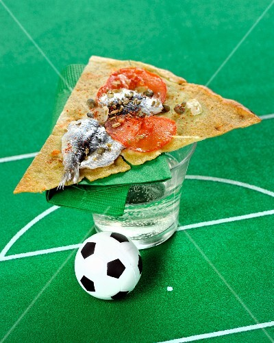 Pane carasau (unleavened bread) with sardines and football decoration