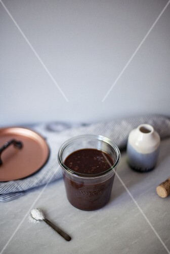 Salted chocolate fudge sauce in a glass