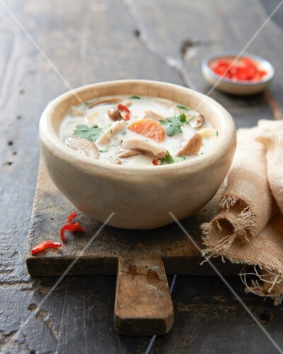 Chicken soup with coconut milk, vegetables and chilli
