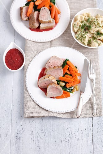 Pork loin with spinach, carrots, cherry sauce and dill Spätzle (soft egg noodles from Swabia)