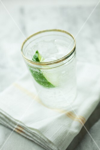 Soda water with lime and ice cubes