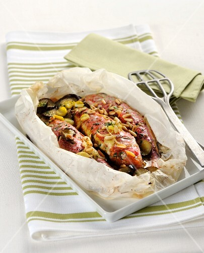 Red mullet with pine nuts in parchment paper