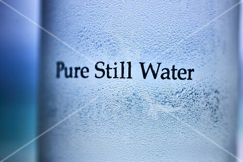 Condensation on a glass with the words 'pure still water'
