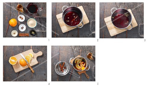 Mulled wine with orange slices being made