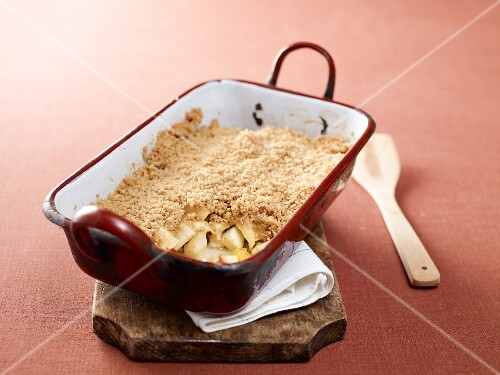 Apple crumble with oranges in a baking dish