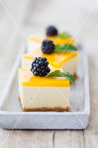 Mango mousse cake with blackberries