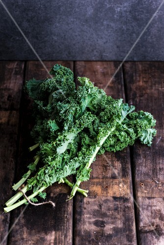 Fresh kale on a wooden surface