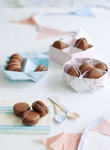 chocolate macaroons in various types of gift packaging