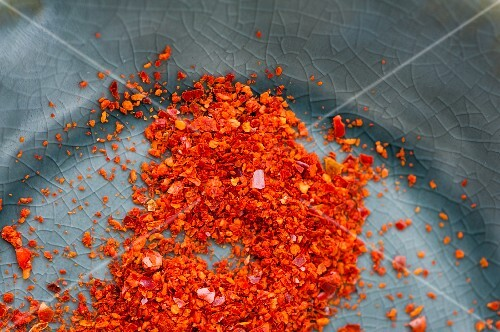 A plate of chilli flakes (close up)