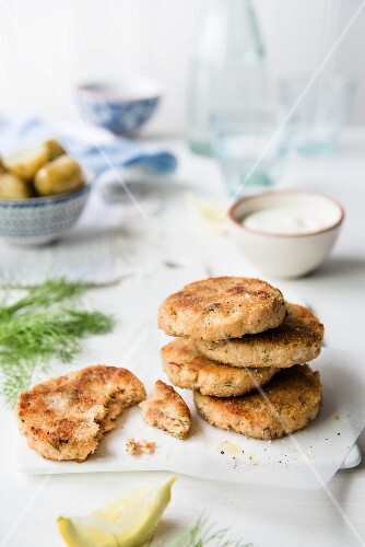 Two Salmon and Dill Fish Cakes on a Plate; Fork