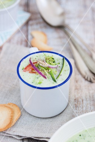 Cold courgette and cucumber soup in an enamel mug